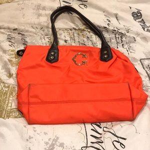 Wonder brand purse in brilliant peach